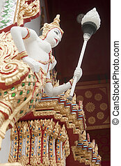 female bird man statue - female bird man in the temple