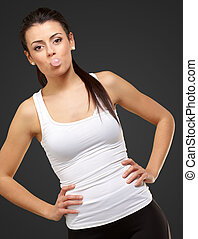 Female Blowing Bubble Gum On Black Background