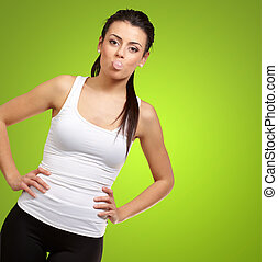 Female Blowing Bubble Gum On Green Background