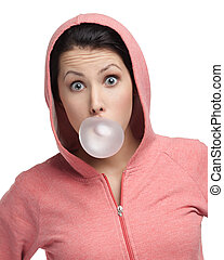 Female in sweatshirt blows out pink bubble gum, isolated on white