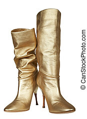 Female boots of gold color on a high heel