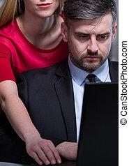 Female boss harassing her employee - Close-up of female boss...