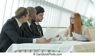 Female boss meets for colleagues - Smiling businessman in a...