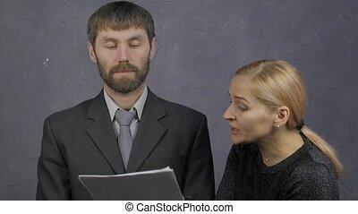 female boss scolds a inattentive male employee. Careless...