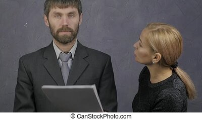 female boss scolds a inattentive male employee. Careless...