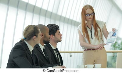 Female boss shows agreement - Smiling businessman in a...
