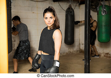 Female boxer in a boxing gym