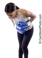 Female Boxer on a White Background is Hurt