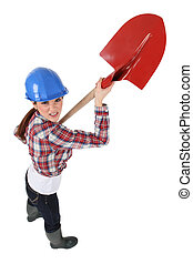 female bricklayer holding trowel
