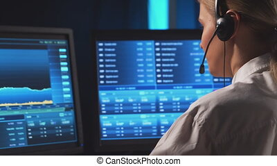 Female broker is workin in office using workstation and analysis technology. Workplace of professional trader. Global financial markets, business strategy, currency exchange and banking concepts.
