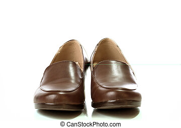 Female brown leather beautiful shoes isolated on a white background