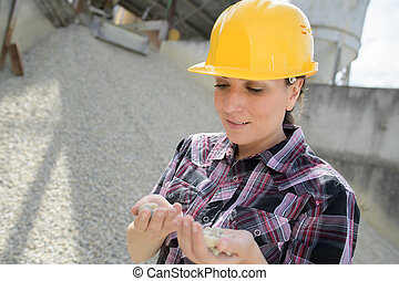 female builder choosing nails