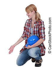 Female builder gesturing