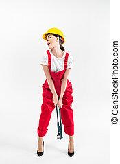 Female builder holding wrench