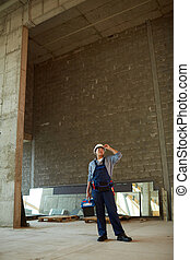 Female Builder on Construction Site Wide Angle