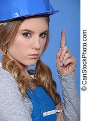 Female builder pointing