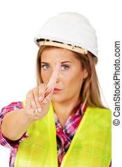Female builder shows one finger