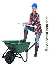 Female builder with wheelbarrow