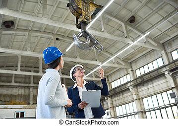 Female building contractors visiting construction site