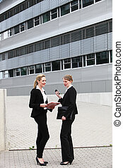 Female business executives outside offices