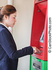 female business hand entering PIN/pass code on ATM/bank machine