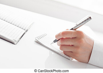 female business hand with pen