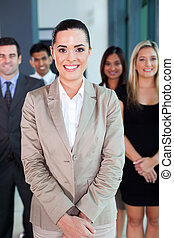 female business leader with team on background - beautiful ...