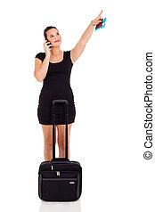 female business traveler pointing up