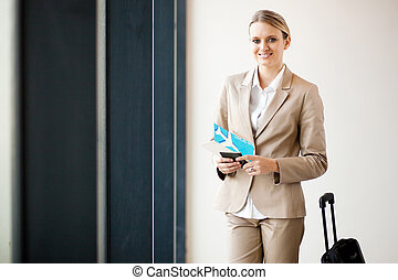 female business traveller waiting in airport
