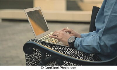 Female businesswoman hands typing on notebook