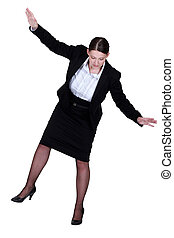 female businesswoman miming tightrope walker