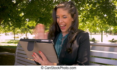 Female businesswoman video chatting with her family while on a business trip