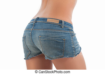 Female buttocks in shorts. Rear view of female buttocks in jeans shorts isolated on white