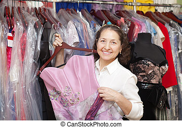Female buyer chooses evening dress