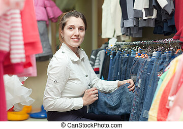 Female buyer chooses jeans