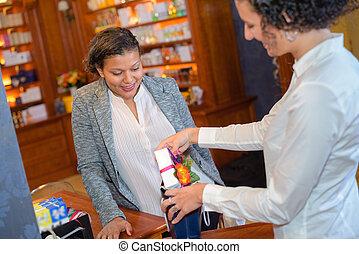 female buyer choosing tea in a shop