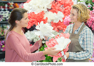 female buying flowers in a store