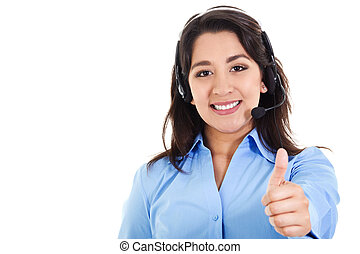 Stock image of female call center operator smiling and giving thumbs up, wearing business attire, isolated on white