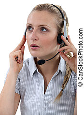 Female call-center worker taking a call from customer