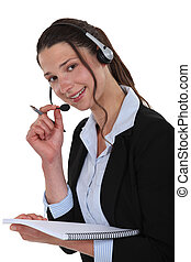 Female call-center worker with note-pad
