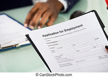 Female Candidate Holding Application Form