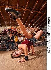 Female Capoeira Performer Kicking