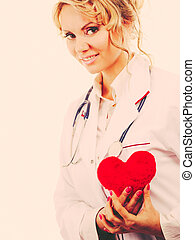 Female cardiologist with red heart.