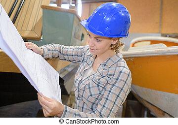 female carpenter in a woodshop