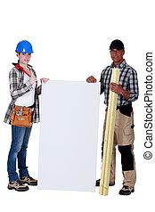 female carpenter posing with senior instructor holding copyspace