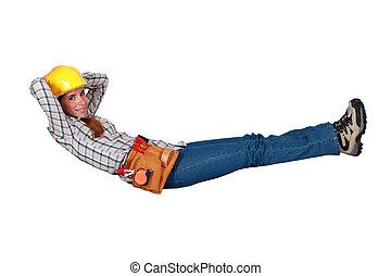 Female carpenter taking a break