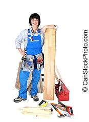 Female carpenter with tools