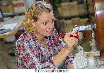 female carpenter working in a woodshop