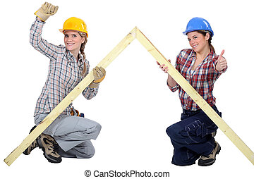 Female carpenters rejoicing