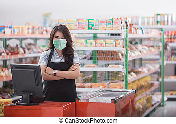 female cashier standing at cash counter